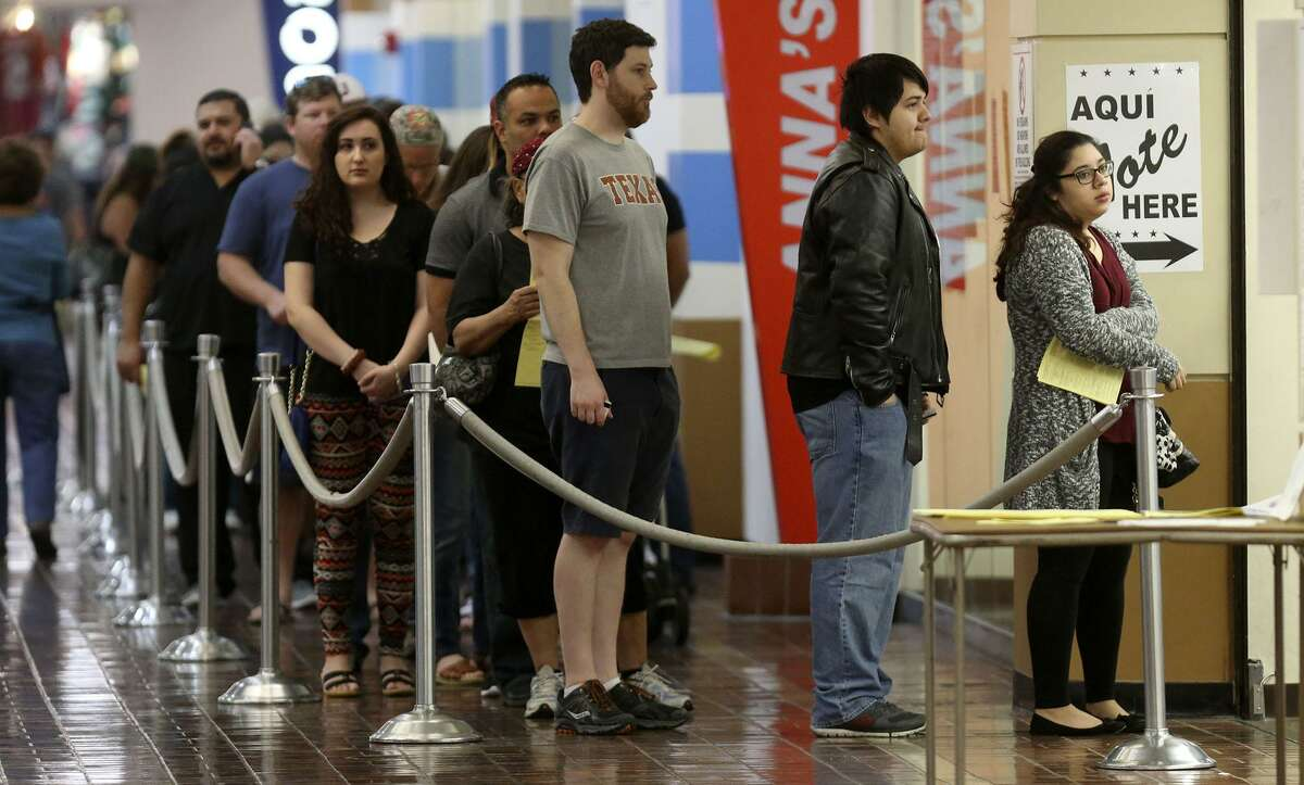 People line up to vote at the Wonderland of the Americas Mall Friday November 4, 2016 on the last day of early voting for the 2016 election.