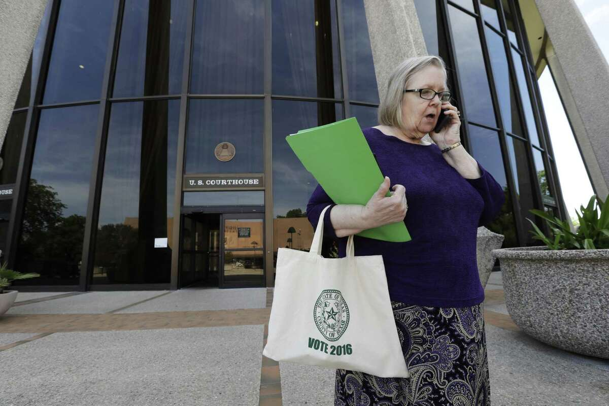 Jacquelyn Callanen, elections administrator for Bexar County, talks outside the U.S. Federal Courthouse, Thursday, April 27, 2017, in San Antonio. Three losses in federal court in barely a month over its voting laws have raised the stakes for Texas at a hearing before a three-judge panel. (AP Photo/Eric Gay)