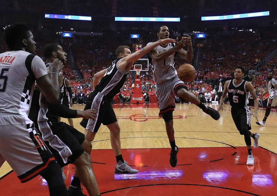 HOUSTON, TX - MAY 11:  David Lee #10 of the San Antonio Spurs defends against Trevor Ariza #1 of the Houston Rockets during Game Six of the NBA Western Conference Semi-Finals at Toyota Center on May 11, 2017 in Houston, Texas.  NOTE TO USER: User expressly acknowledges and agrees that, by downloading and or using this photograph, User is consenting to the terms and conditions of the Getty Images License Agreement.  (Photo by Ronald Martinez/Getty Images) Photo: Ronald Martinez/Getty Images