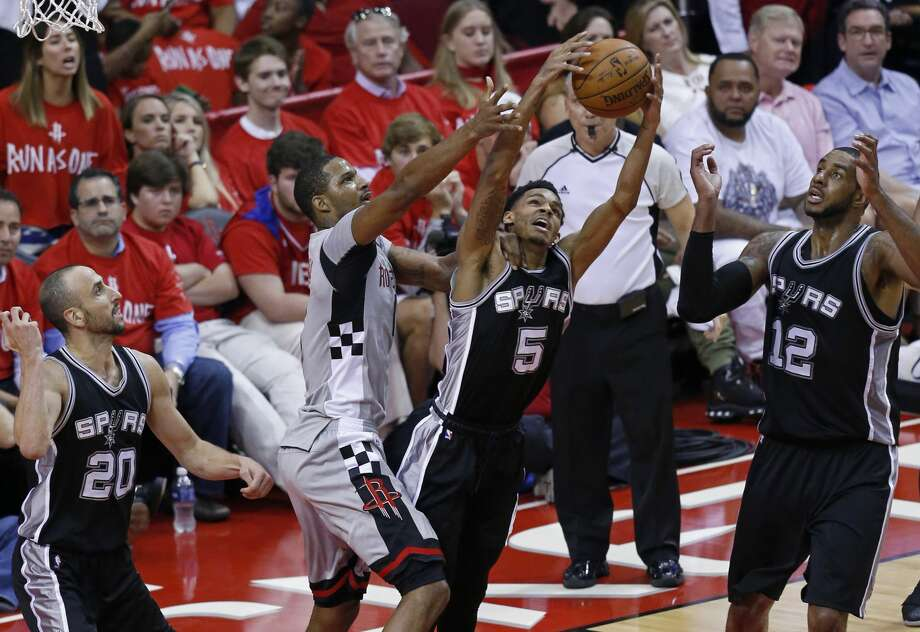 San Antonio Spurs' Dejounte Murray and Houston RocketsÕ Trevor Ariza grab for a rebound as San Antonio Spurs' Manu Ginobili and  LaMarcus Aldridge look on during second half action of Game 6 in the Western Conference semifinals held Thursday May 11, 2017 at the Toyota Center in Houston,Tx. Photo: Edward A. Ornelas/San Antonio Express-News