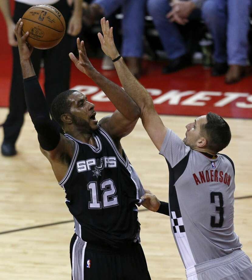 San Antonio Spurs' LaMarcus Aldridge shoots around Houston RocketsÕ Ryan Anderson during second half action of Game 6 in the Western Conference semifinals held Thursday May 11, 2017 at the Toyota Center in Houston,Tx. Photo: Edward A. Ornelas/San Antonio Express-News