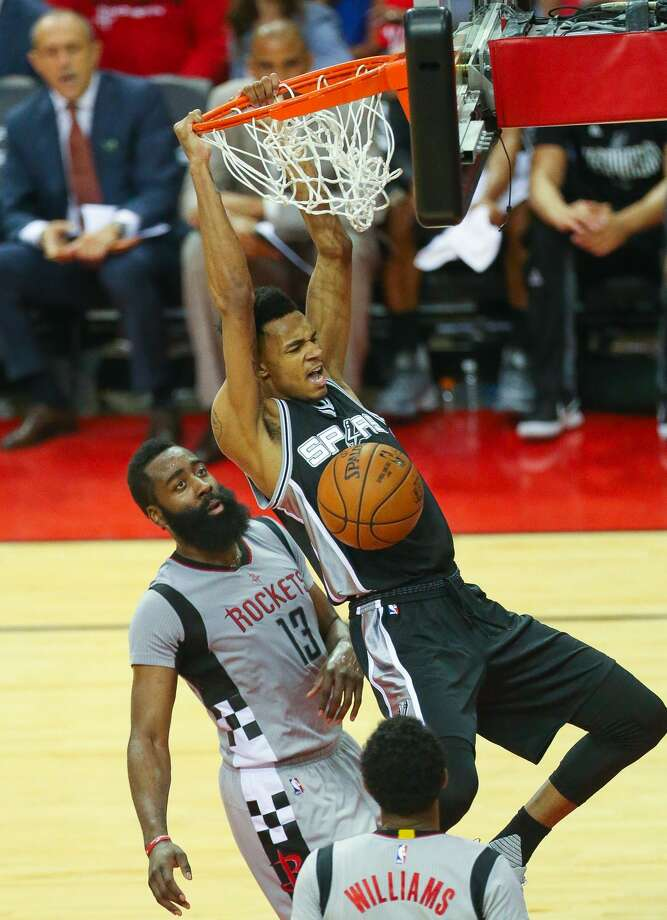 San Antonio Spurs guard Dejounte Murray (5) dunks in front of Houston Rockets guard James Harden (13) during the second half of Game 6 of the Western Conference semi-final series between the Houston Rockets and San Antonio Spurs at Toyota Center, Thursday, May 11, 2017, in Houston. (Mark Mulligan / Houston Chronicle) Photo: Mark Mulligan/Mark Mulligan / Houston Chronicle