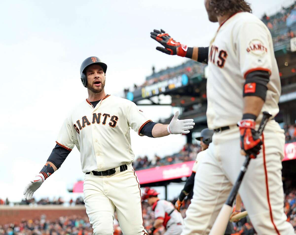 San Francisco Giants' Brandon Belt celebrates his solo home run with Brandon Crawford in 1st inning against Cincinnati Reds during MLB game at AT&T Park in San Francisco, Calif., on Thursday, May 11, 2017.