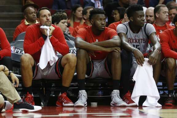 The starters James Harden, forward Ryan Anderson, and center Clint Capela watch after they were pulled from the game to allow the bench players in during the second half of Game 6 of the second round of the Western Conference NBA playoffs at the Toyota Center, Thursday, May 11, 2017, in Houston. ( Karen Warren / Houston Chronicle )