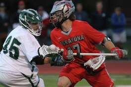 Niskayuna's Lucas Quinn advances the ball under pressure from Shen's Will Hubschmitt during the Suburban Council varsity lacrosse matchup Thursday, May 11, 2017 at Shenendehowa High School. (Ed Burke photo - Special to The Times Union)