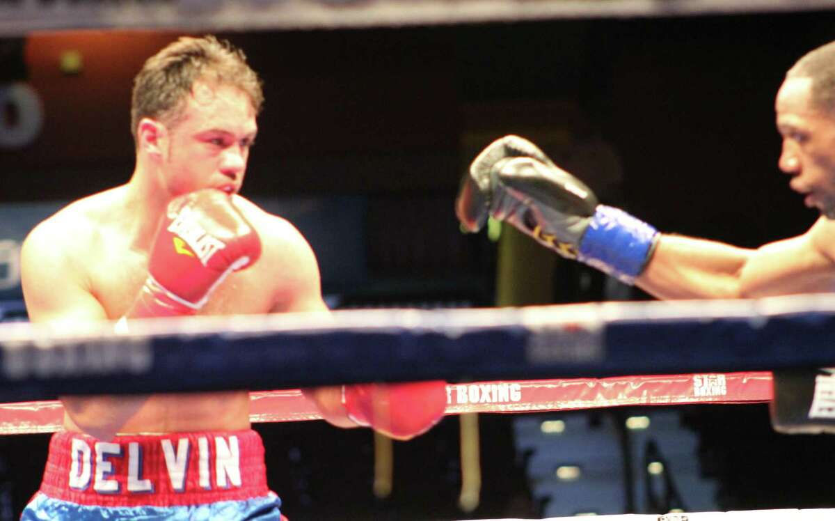 """Boxer Delvin Rodrgiguez of Danbury, left, fights with Courtney Pennington of Brooklyn, N.Y., in the main event in the """"Slugfest at the Sun"""" boxing event at the Mohegan Sun May 11, 2017."""