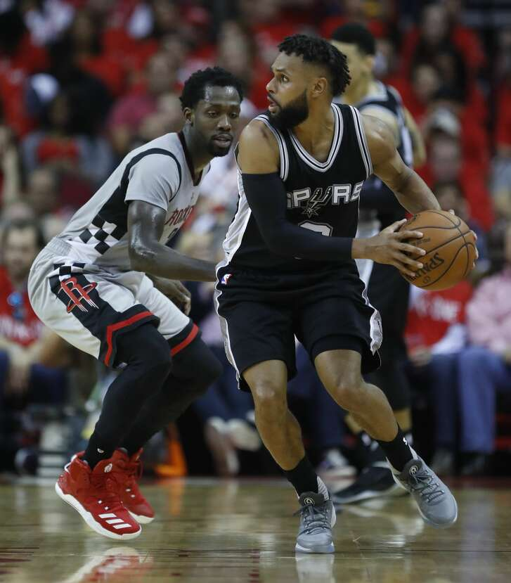 San Antonio Spurs guard Patty Mills (8) works against Houston Rockets guard Patrick Beverley (2) during the second half of Game 6 of the second round of the Western Conference NBA playoffs at the Toyota Center, Thursday, May 11, 2017, in Houston. ( Karen Warren / Houston Chronicle )