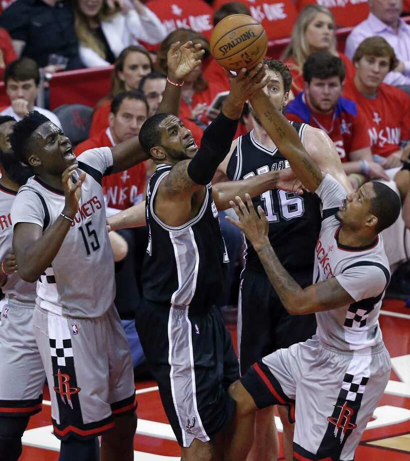 San Antonio Spurs' LaMarcus Aldridge grabs for a rebound between Houston RocketsÕ Clint Capela (left) and Trevor Ariza during first half action of Game 6 in the Western Conference semifinals held Thursday May 11, 2017 at the Toyota Center in Houston,Tx. Photo: Edward A. Ornelas, Staff / San Antonio Express-News / © 2017 San Antonio Express-News