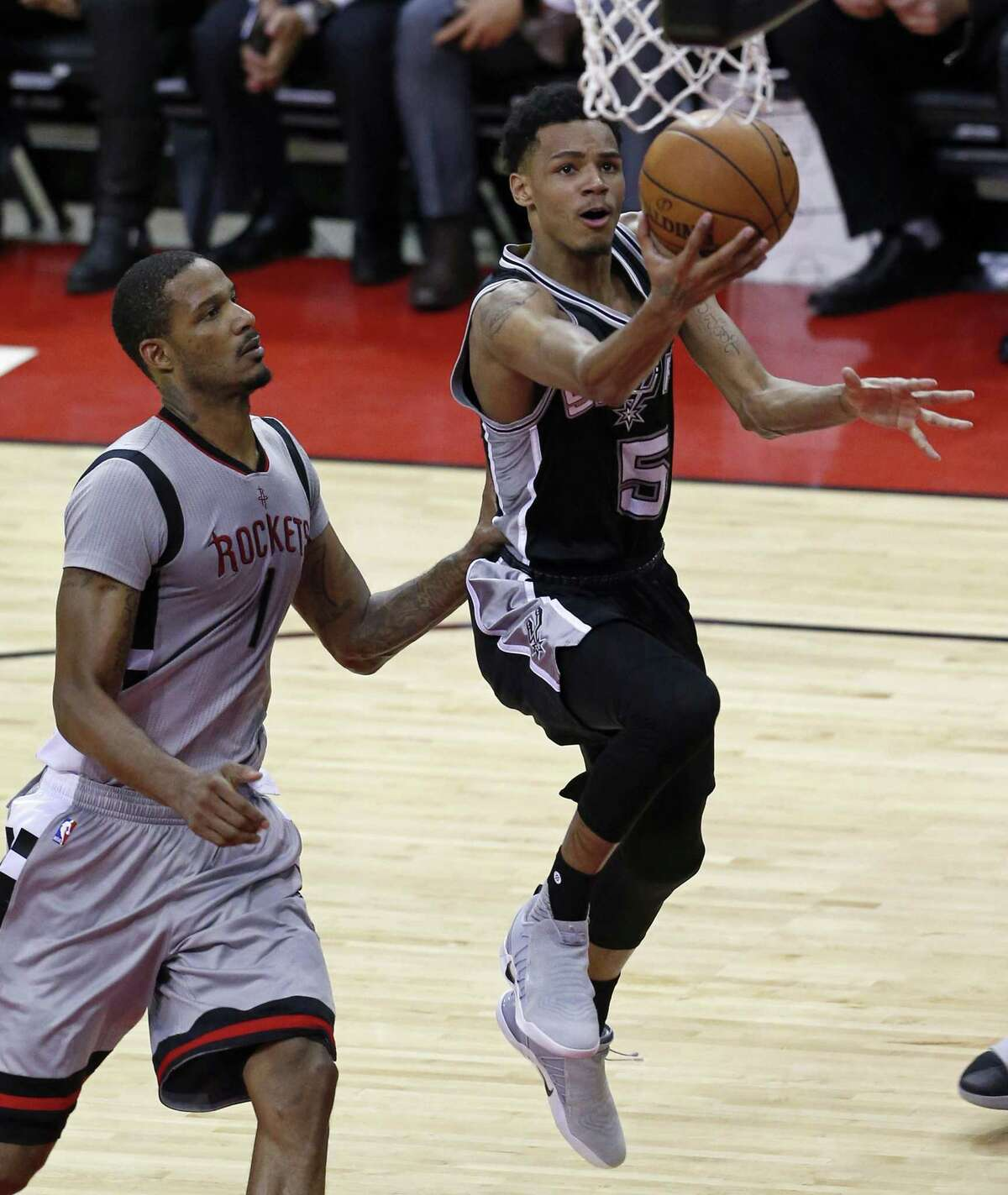 San Antonio Spurs' Dejounte Murray shoots around Houston Rockets?• Trevor Ariza during second half action of Game 6 in the Western Conference semifinals held Thursday May 11, 2017 at the Toyota Center in Houston,Tx. The Spurs won 114-75.
