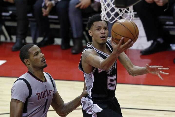 San Antonio Spurs' Dejounte Murray shoots around Houston RocketsÕ Trevor Ariza during second half action of Game 6 in the Western Conference semifinals held Thursday May 11, 2017 at the Toyota Center in Houston,Tx. The Spurs won 114-75.