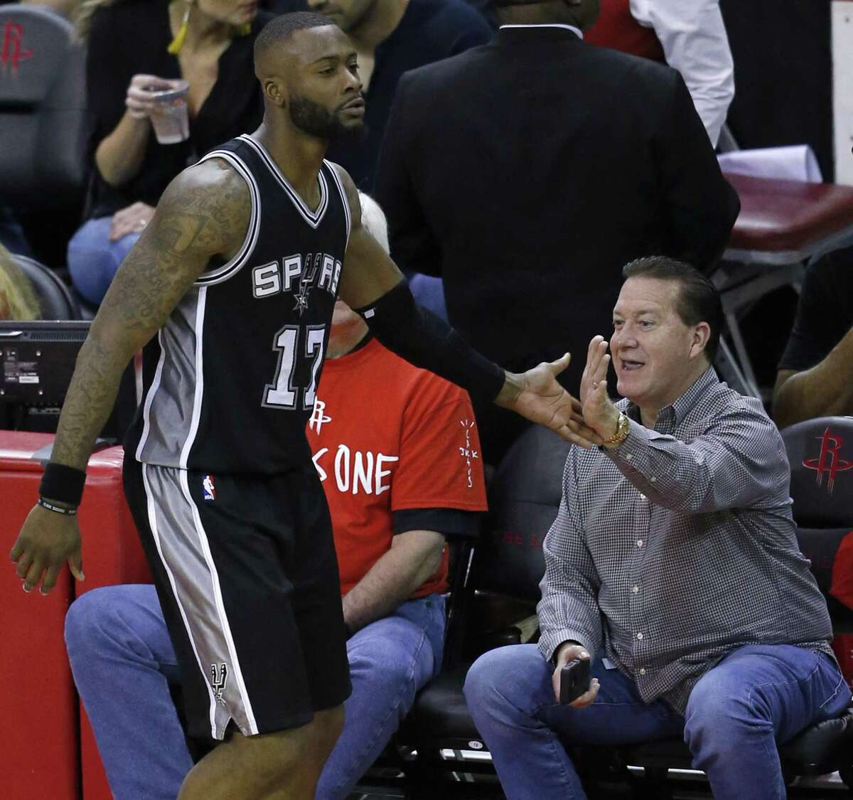 Spurs' Jonathon Simmons greets fans as he walks to the bench during a timeout in second half action of Game 6 against the Rockets in the Western Conference semifinals on May 11, 2017 at the Toyota Center in Houston.