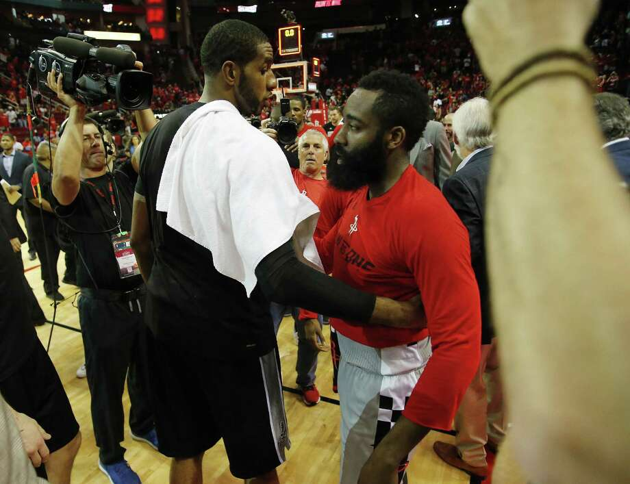 Spurs' LaMarcus Aldridge (12) and Houston Rockets' James Harden (13) meet at the end of Game 6 of the Western Conference semifinals at the Toyota Center on Thursday, May 11, 2017. Spurs defeated the Rockets, 114-75, to win the series and advance to the Western Conference Finals against the Golden State Warriors. (Kin Man Hui/San Antonio Express-News) Photo: Kin Man Hui, Staff / San Antonio Express-News / ©2017 San Antonio Express-News