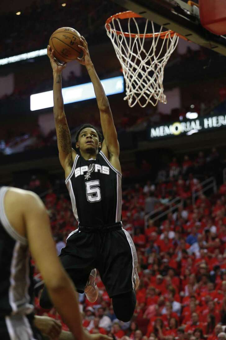 Dejounte Murray  dunks in the Spurs' blowout victory that closed out the Rockets in Houston.