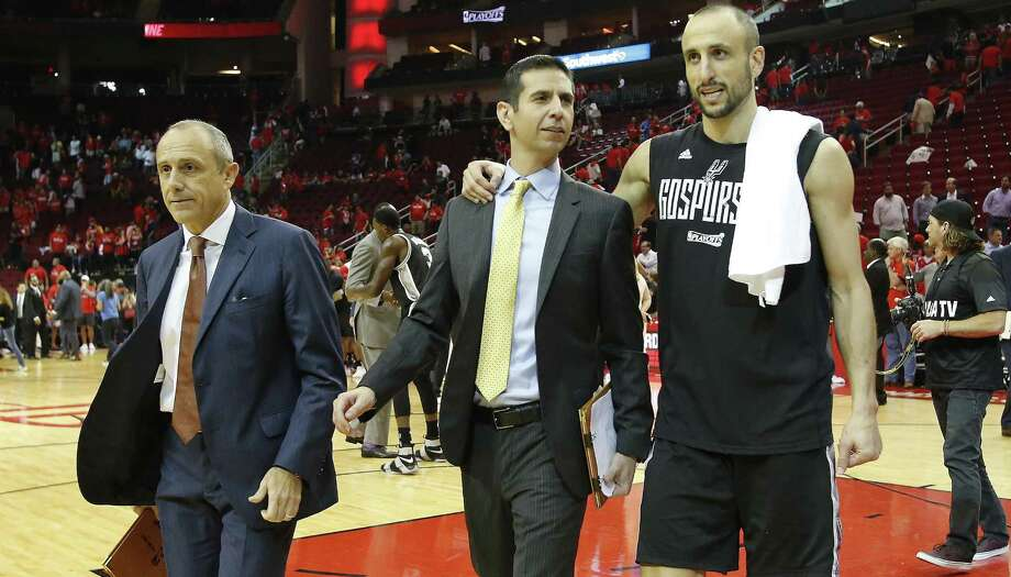 Spurs' Manu Ginobili walks to the locker room with coaches Ettore Messina (left) and James Borrego after defeating the Houston Rockets in Game 6 of the Western Conference semifinals at the Toyota Center on May 11, 2017. Photo: Kin Man Hui /San Antonio Express-News / ©2017 San Antonio Express-News
