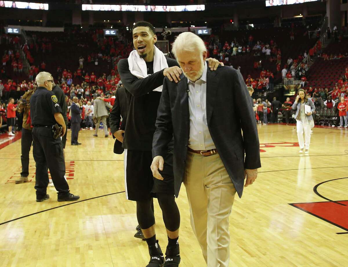 Spurs' Danny Green (14) and Spurs head coach Gregg Popovich walk back to the locker room after defeating the Houston Rockets in Game 6 of the Western Conference semifinals at the Toyota Center on Thursday, May 11, 2017. Spurs defeated the Rockets, 114-75, to win the series and advance to the Western Conference Finals against the Golden State Warriors. (Kin Man Hui/San Antonio Express-News)