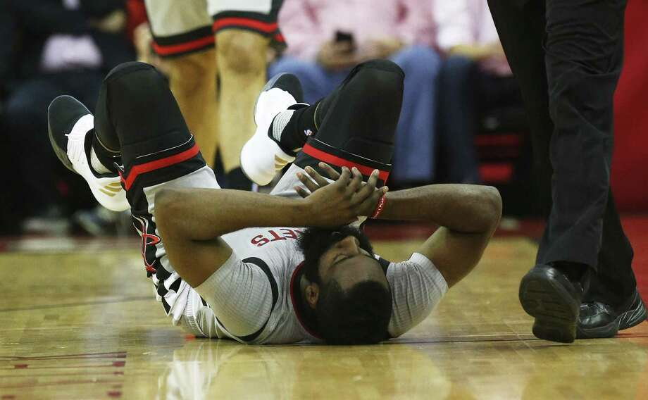 Rockets' James Harden (13) falls to the floor after being fouled during Game 6 of the Western Conference semifinals against the Spurs at the Toyota Center on May 11, 2017. Photo: Kin Man Hui /San Antonio Express-News / ©2017 San Antonio Express-News