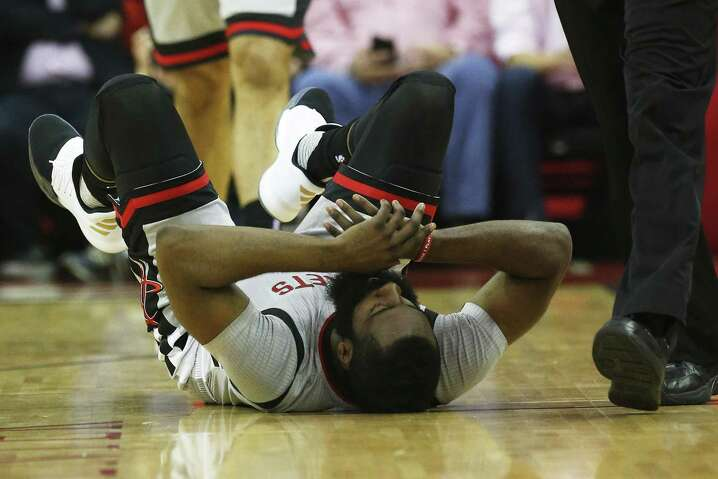 Rockets' James Harden (13) falls to the floor after being fouled during Game 6 of the Western Conference semifinals against the Spurs at the Toyota Center on May 11, 2017.