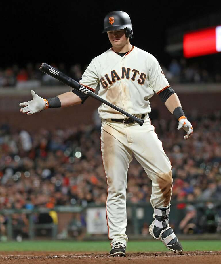 Christian Arroyo, shown in a May game with the Giants, was struck on the finger Saturday in his second at-bat back from another hand injury. Photo: Scott Strazzante, The Chronicle