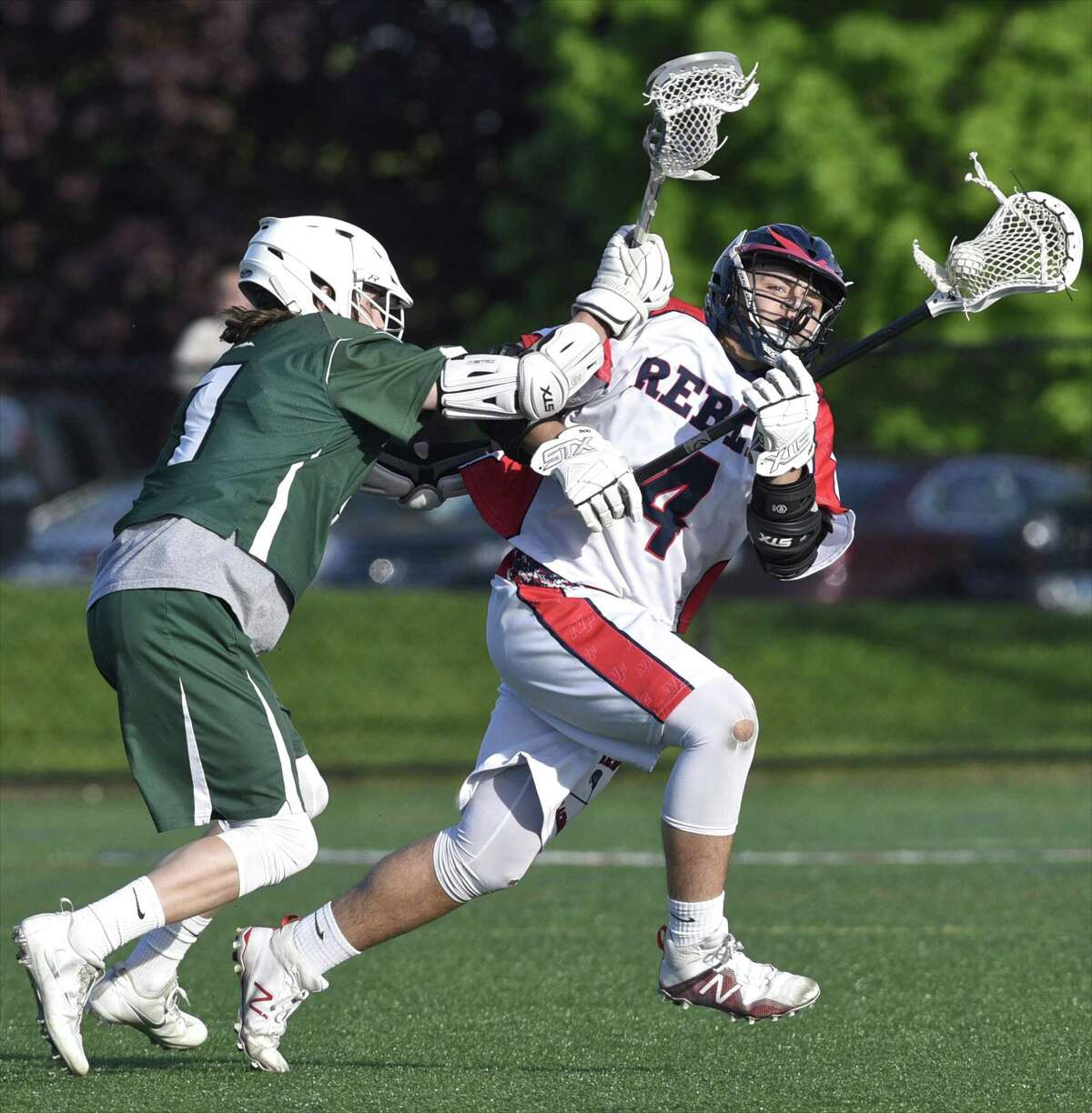 New Fairfield's Zachary Buffington (4) looks to go around New Milford's William Gully during their game Thursday, at New Fairfield High School. The Rebels won 17-5.