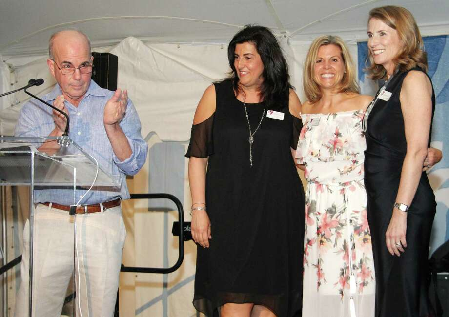 New Canaan YMCA Board Chairman Peter Skaperdas, left, and Kelly DeFrancesco, April Kaynor and Kristin Selvala, who co-chaired the Y's gala, speak to those gathered on April 29 at Waveny Mansion. Photo: Contributed Photo / New Canaan News