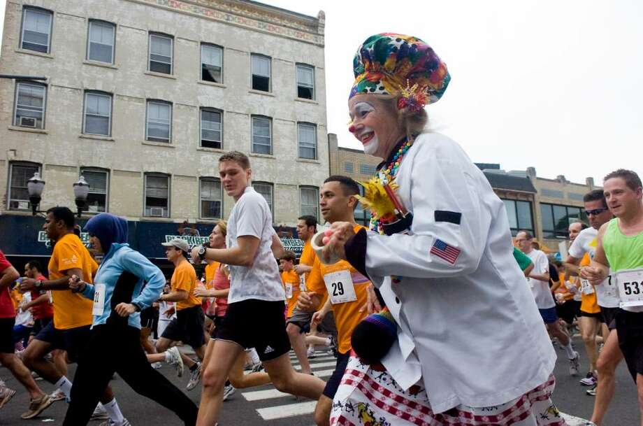Stamford Hospital's Health and Humor Associate Clowns participate in the 15th anniversary of Stamford HospitalÕs Hope in Motion Walk, Run & Ride at Columbus Park Sunday June 6, 2010. More than 3,500 people turned out to participate in the event which included a 50-mile bike ride, a 5K run and a 5K walk through Stamford Downtown followed by musical performances and dancing in Columbus Park. Photo: Keelin Daly / Stamford Advocate