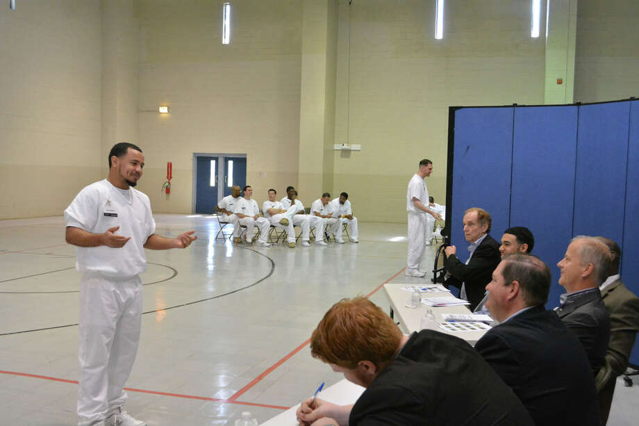 A prisoner enrolled in the Prison Entrepreneurship Program makes a pitch to a panel of judeges in preparation for a business plan competition at the Cleveland Correctional Center in Cleveland, Texas. Photo: Handout