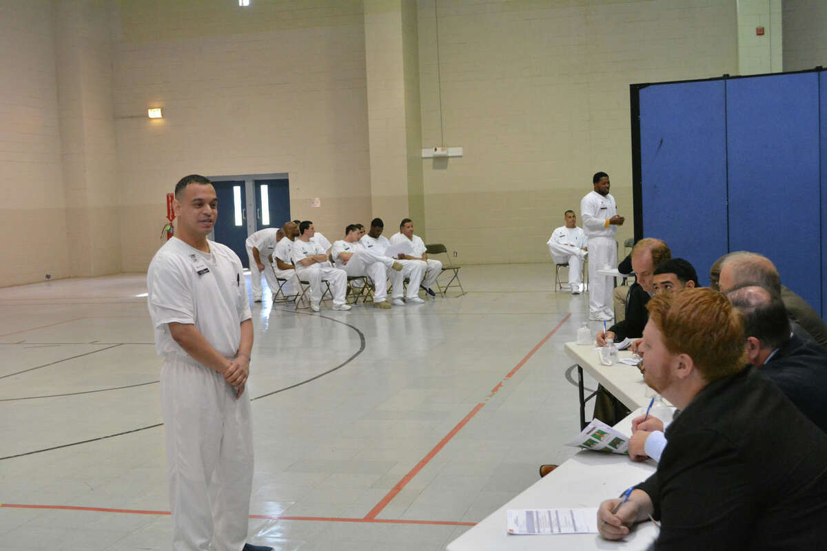 A prisoner enrolled in the Prison Entrepreneurship Program makes a pitch to a panel of judeges in preparation for a business plan competition at the Cleveland Correctional Center in Cleveland, Texas.
