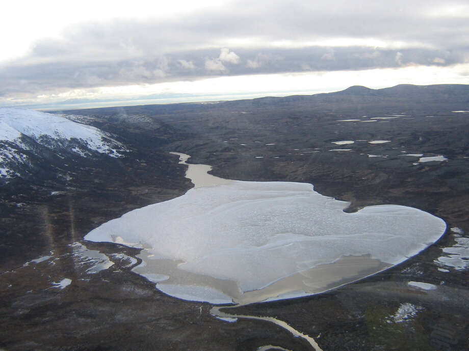 Aerial view from a helicopter showing the landscape on which the proposed Pebble Mine, a gold and copper mine. would be placed. Here, Frying Pan Lake, which under current plans would disappear under a giant pile of tailing. Photo: Washington Post Photo By Karl Vick. / The Washington Post