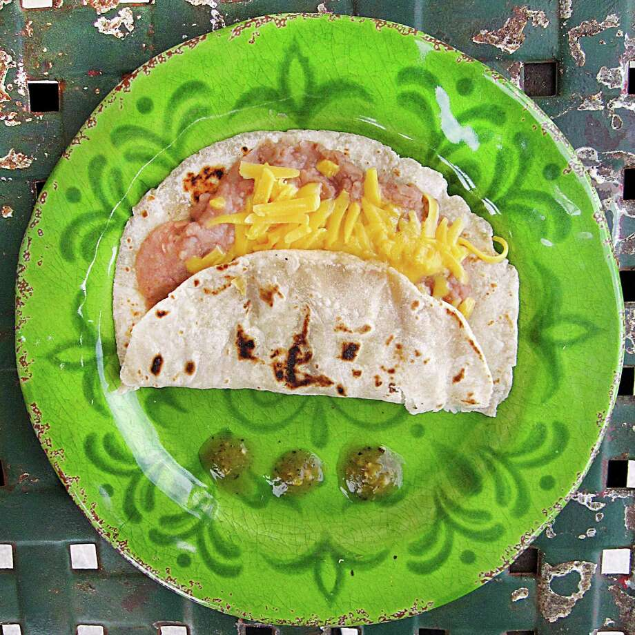 Bean and cheese taco on a handmade flour tortilla from Maria's Cafe on Nogalitos Street. Photo: Mike Sutter /San Antonio Express-News