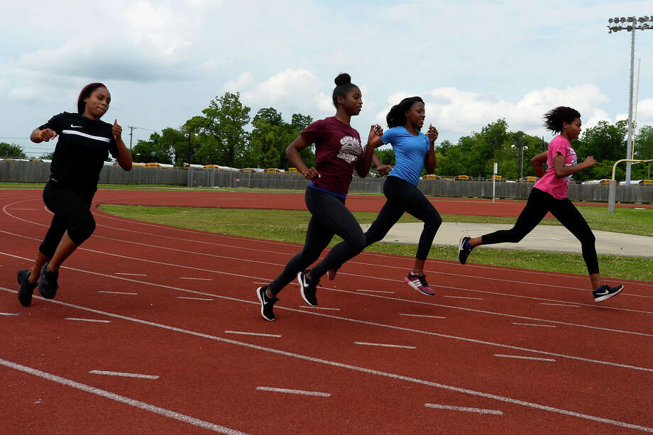 Marissa Savoy, Maya Kelly, Kayliah Carr and Briana Mouton of Central's girls 4x100 relay team warm up together during practice at Babe Zaharias Stadium on Tuesday afternoon. The team will compete in the state track meet in Austin.  Photo taken Tuesday 5/9/17 Ryan Pelham/The Enterprise Photo: Ryan Pelham / ©2017 The Beaumont Enterprise/Ryan Pelham