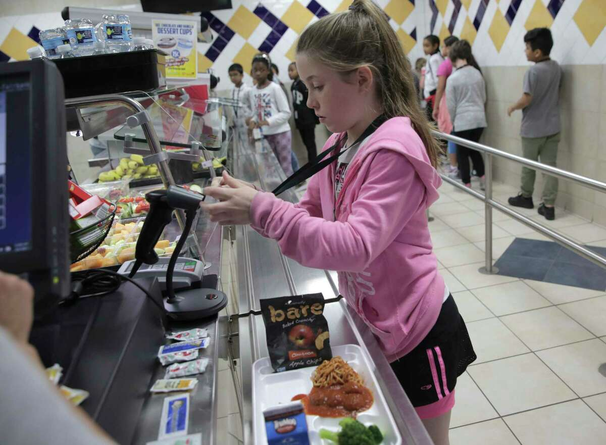 Hancock Elementary fourth grader Allison Irby pays for her lunch on Thursday, April 6, 2017, in Houston. The school offers a program where parents can put extra money in the funds so students who forget their lunch money get a full meal. ( Elizabeth Conley / Houston Chronicle ) Scroll through the gallery to see what school lunches look like at Houston area schools