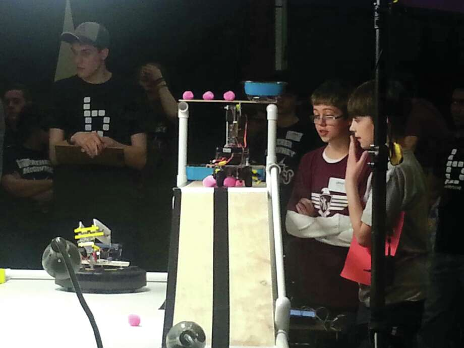 St. Mary's Elementary School students conduct a robotics demonstration during the school's STREAM night, where students showcased their projects from throughout the year. Photo: For The Intelligencer