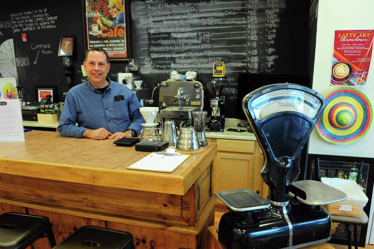 Ed Freedman, owner of Shearwater Organic Coffee Roasters, poses at the shop which is located at 100 Corporate Drive in Trumbull, Conn., on Tuesday May 10, 2017. Freedman said the roastery supports Fairtrade coffee.