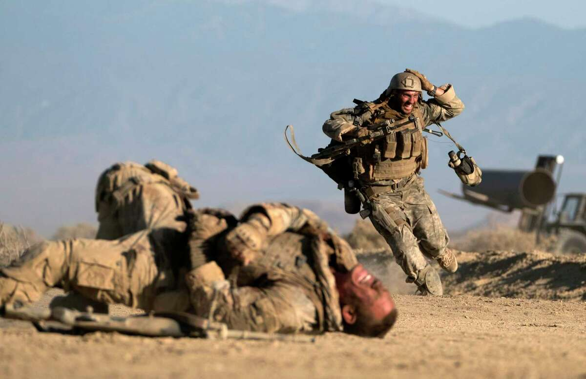 John Cena and Aaron Taylor-Johnson star in Iraq war drama about two American  soldiers pinned down by an enemy sniper.