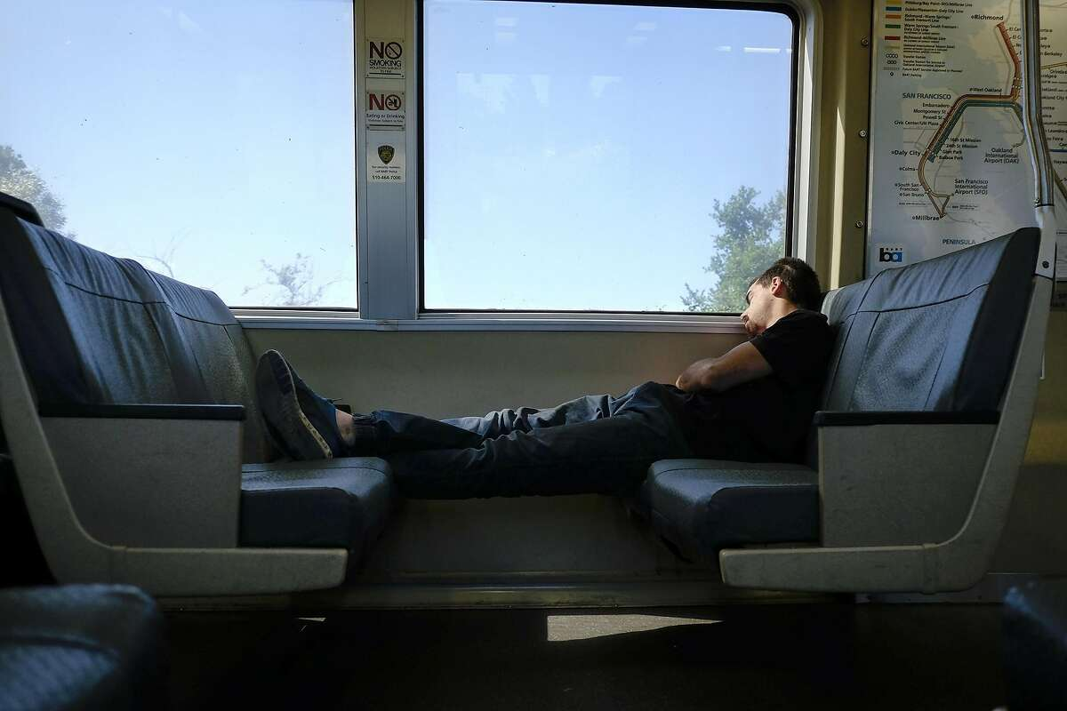 A person takes up two seats on a Richmond bound BART train in Richmond, CA, on Friday May 12, 2017.