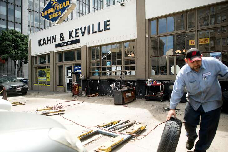 Guillermo Mendez changes a car tire at Kahn & Keville, located at 500 Turk St., on Thursday, May 4, 2017, in San Francisco. The site is under consideration for affordable housing development.