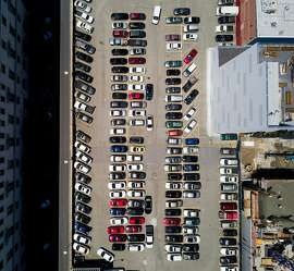 Cars line a parking lot at 1064 Mission St. on Thursday, May 4, 2017, in San Francisco. The site is under consideration for affordable housing development.