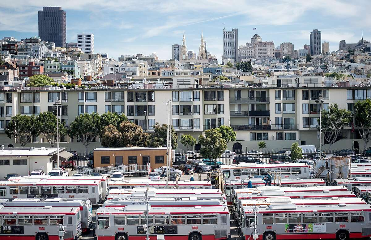 Busses sit parked at Muni's Kirkland Yard, located at 2301 Stockton St., on Thursday, May 4, 2017, in San Francisco. The site is under consideration for affordable housing development.