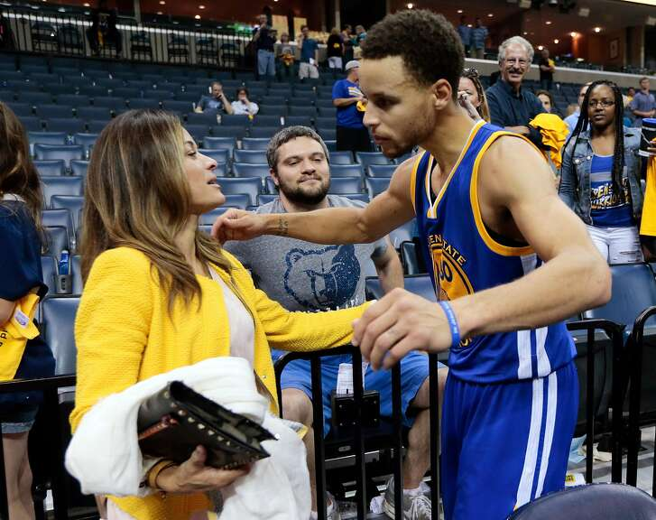 Golden State Warriors guard Stephen Curry hugs his mother, Sonya Curry, after the Warriors beat the Memphis Grizzlies in Game 6 of a second-round NBA basketball Western Conference playoff series Friday, May 15, 2015, in Memphis, Tenn. The Warriors won 108-95 to win the series 4-2. (AP Photo/Mark Humphrey)