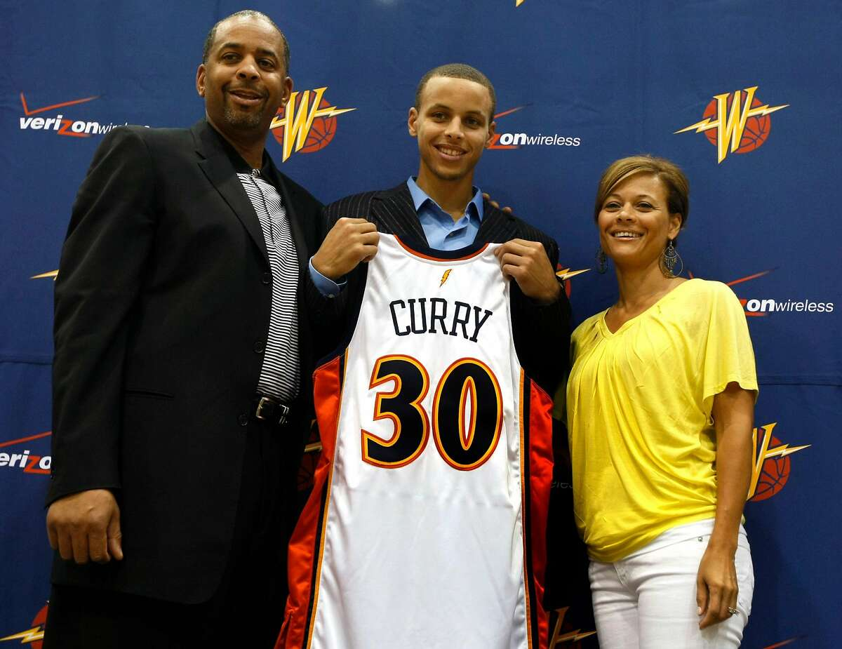 Stephen Curry poses with his parents Dell Curry who played 16 seasons in the MBA and his mother Sonya Curry after a press conference at Warriors headquarters in Oakland, Calif, Friday, June 26, 2009.