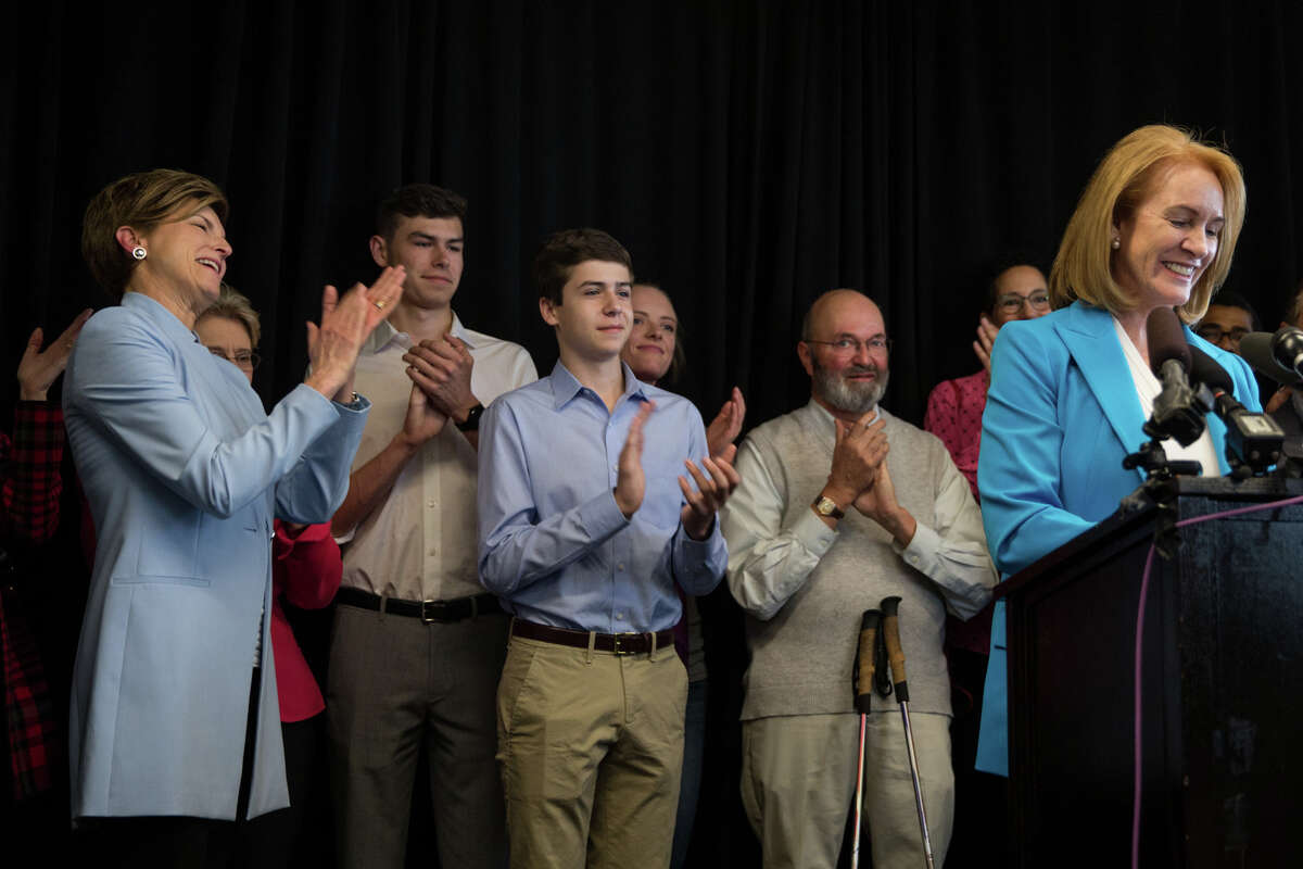 Former U.S. Attorney Jenny Durkan's family, partner Dana Carvey, and sons Coleman and James Ryan, clap as Durkan speaks while announcing her candidacy in the 2017 Seattle mayoral race, at Pacific Tower on Friday, May 12, 2017.