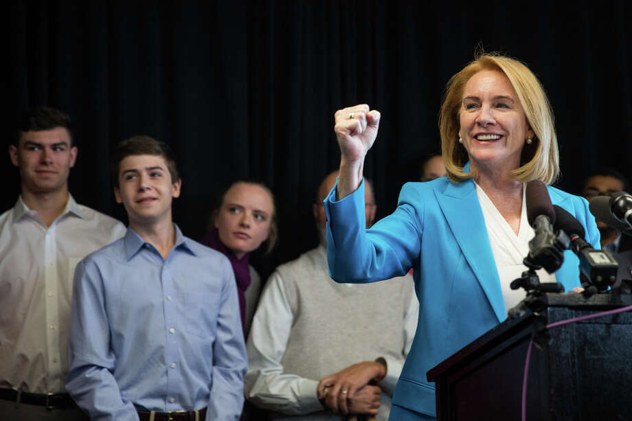 Former U.S. Attorney Jenny Durkan raises a fist as a horn goes off outside the room as she announces her candidacy in the 2017 Seattle mayoral race, at Pacific Tower on Friday, May 12, 2017. Photo: GRANT HINDSLEY, SEATTLEPI.COM / SEATTLEPI.COM