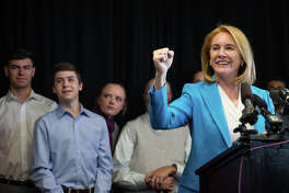 Former U.S. Attorney Jenny Durkan fist bumps as a horn goes off outside the room as she announces her candidacy in the 2017 Seattle mayoral race, at Pacific Tower on Friday, May 12, 2017.