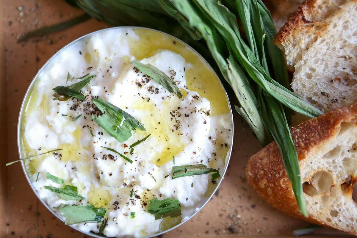 One of Anthony Strong's newest dishes, a spring onion Burrata dip, will be features at Young Fava, San Francisco's first delivery-only restaurant on Sunday, May 6, 2017 in San Francisco, Calif.