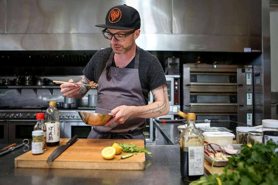 Anthony Strong prepares one of his new dishes, '90s-style Ahi Crudo, for his new cooking venture, Young Fava. Photo: Amy Osborne, Special To The Chronicle