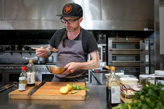 Anthony Strong taste tests as he prepares one of his new dishes, 90's style Ahi Crudo, for his new cooking venture Young Fava on Sunday, May 6, 2017 in San Francisco, Calif.