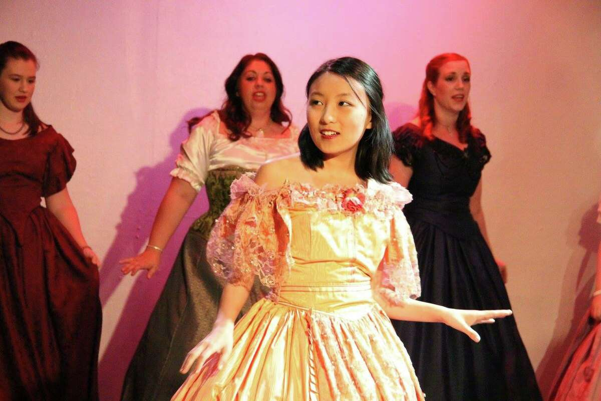 """Caroline Donica as Angelica Schuyler, front, performs in """"Helpless"""" a part of the """"The Chronicles of Hamilton,"""" presented each month by the Majestic Performance Company. At back are Christina Hodson, left, Laurice Larsen and Whitney Wyatt."""