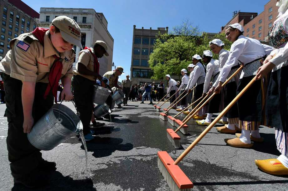 Members of Scout Troop 2 and Cub Scout Pack 149 pour water on State Street for the street washing ceremony as part of the 2017 Albany Tulip Festival on Friday, May 12, 2017, in Albany, N.Y.  (Skip Dickstein/Times Union) Photo: SKIP DICKSTEIN, Albany Times Union / 20040471A