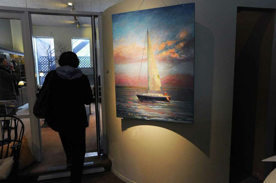A Janice Lockhart painting of a sailboat could be seen in the Christian Science Reading Room during the opening night of Art to the Avenue, celebrating its 20th year on Greenwich Avenue in Greenwich, Conn., Thursday night, May 4, 2017. The event runs until May 29th with the art available for viewing in all the participating stores. Lockhart is a Darien resident. Photo: Bob Luckey Jr. / Hearst Connecticut Media / Greenwich Time