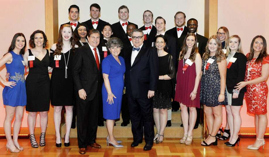 New Canaan's Frank and Marisa Martire and Sacred Heart University President John celebrate with scholarship students at the school's annual Discovery Gala on April 21. Photo: Tracy Deer-Mirek / Contributed Photo / © Sacred Heart University 2017